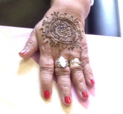 A hand with Henna art on it